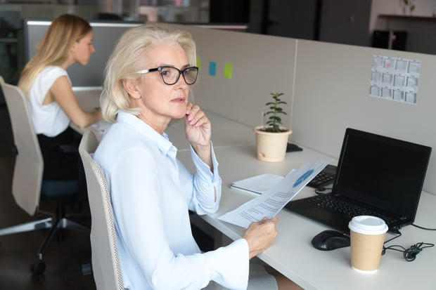 pensive mature woman in office