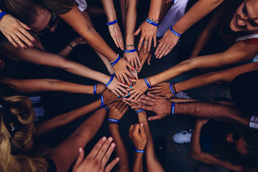 A leader brings diverse people together to solve problems